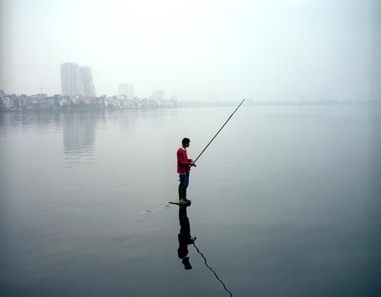 Man in Red Sweater Fishing, 2010