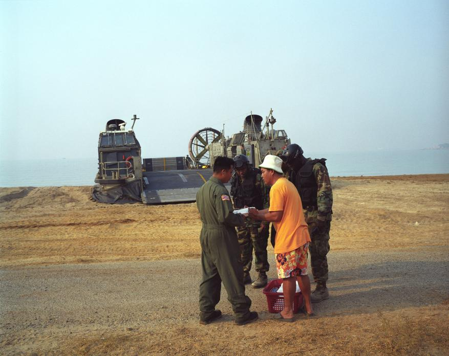 Thai beach vendor and US Marines during 'Cobra Gold' military  exercises, Thailand. 2008