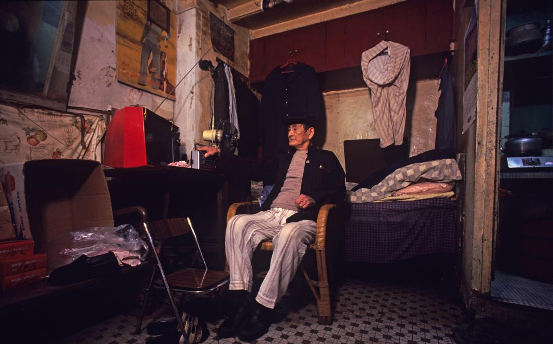 Walled city resident in his 7x12 ft home, 1989