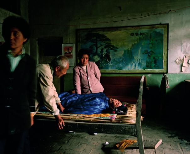Deathbed in Qu Family Home. 'Bitter Waters'. National Geographic, May 2008