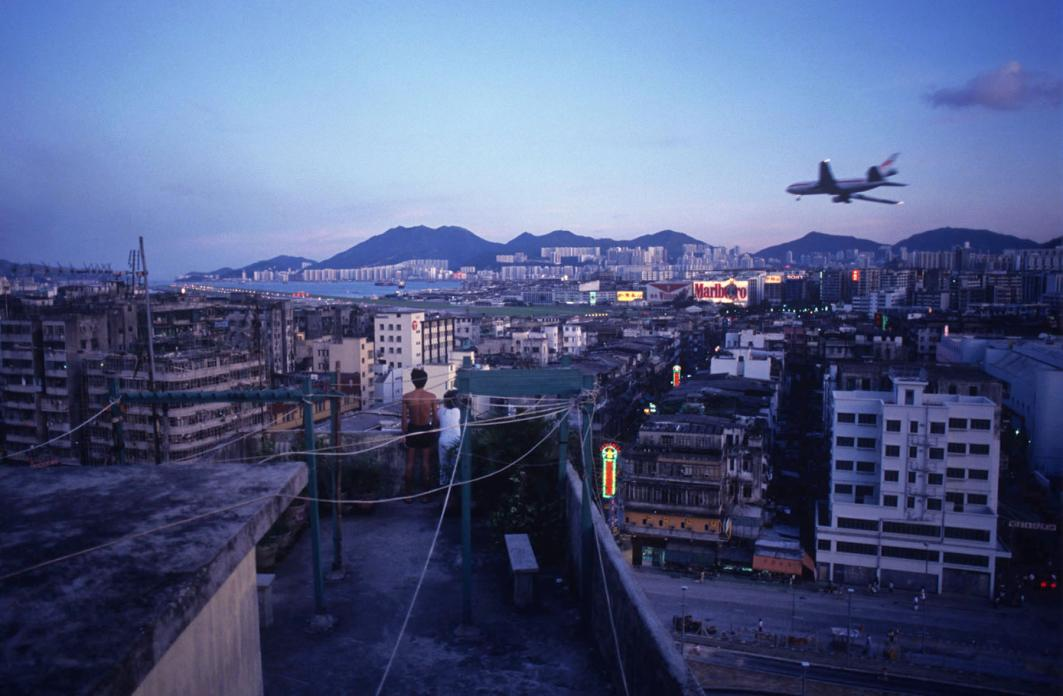 Watching aircraft land at Kai Tak Airport from Walled City rooftop, 1990